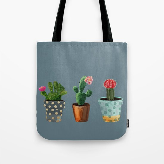 Three Cacti With Flowers On Blue Background Tote Bag