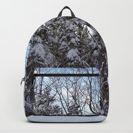 Heavy Snow on Trees under a Blue Sky Backpack
