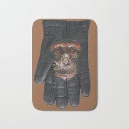Chimpanzee portrait on lost glove Bath Mat