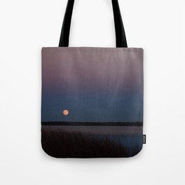 Supermoon rising into a twilight sky Tote Bag
