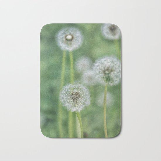 Dandelion flower on green meadow Bath Mat