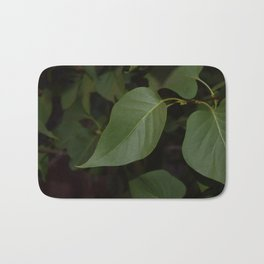 blacked out leaves Bath Mat