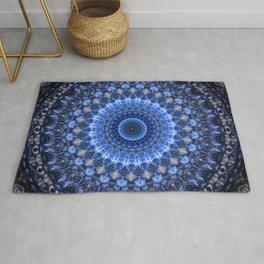 Glowing mandala in blue tones Rug
