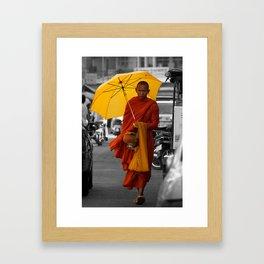 Monk on city street Framed Art Print