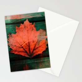Rusty red dried fall leaf on wooden hunter green beams Stationery Cards