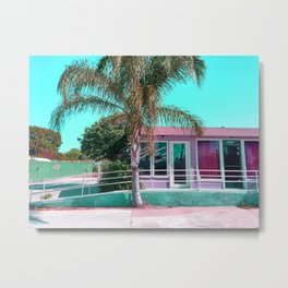 pink building in the city with palm tree and blue sky Metal Print