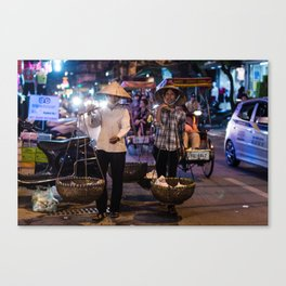 Women selling food in the streets of Hanoi Canvas Print