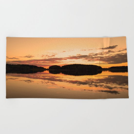 Beautiful sunset - glowing orange - forest silhouette and reflection Beach Towel