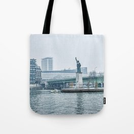 Snownfall over Replica of the Statue of Liberty in Paris Tote Bag