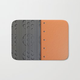 Colored plate with rivets and circular metal grille Bath Mat