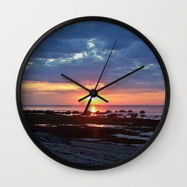 Sunset under Stormy Skies Wall Clock