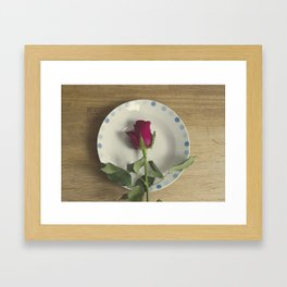 Red rose on a plate Framed Art Print