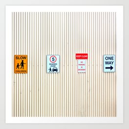 Signs on a corrugated metal wall Art Print