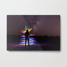 A woman standing at night with lightpainting effects with the lacteal way background Metal Print