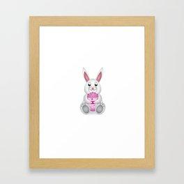 Easter bunny with pink egg Framed Art Print