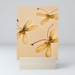 Seed butterflies Mini Art Print