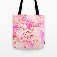 bible verse Tote Bags featuring FOLLOW THE WAY OF LOVE Pretty Pink Floral Christian Corinthians Bible Verse Typography Abstract Art by The Faithful Canvas
