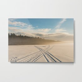 Crossing tracks on snow covered frozen lake Metal Print