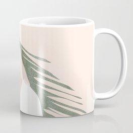 Holding a Palm Leaf Coffee Mug