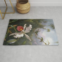 Martin Johnson Heade - Two hummingbirds above a white orchid Rug