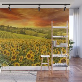 Red sunset over the rolling sunflowers and sunflower fields of Tuscany, Italy Wall Mural