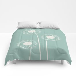 Pale dandelions and flying seeds Comforters