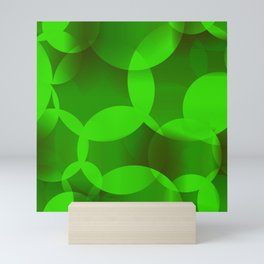 Abstract soap  of green molecules and bubbles on a light background. Mini Art Print