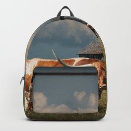 Longhorn Steer in a Prairie pasture by 1880 Town with Windmill and Old Gray Wooden Barn Backpack