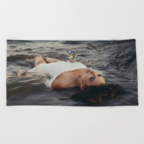 floating light Beach Towel