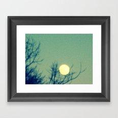 Tree holding the moon Framed Art Print