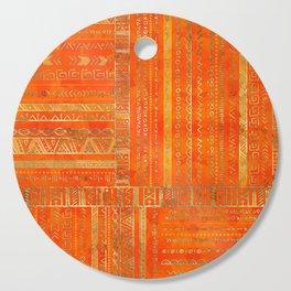 Tribal Ethnic pattern gold on bright orange Cutting Board