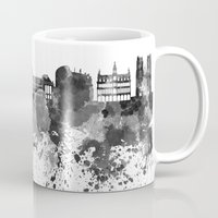 brussels Mugs featuring Brussels skyline in black watercolor by Paulrommer