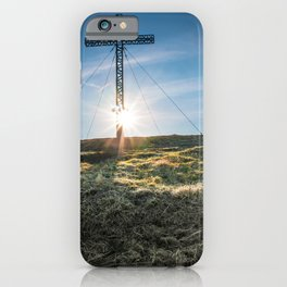 Cross shape front of sunlight glow on hill top mountain iPhone Case