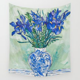 Iris Bouquet in Chinoiserie Vase on Blue and White Striped Tablecloth on Painterly Mint Green Wall Tapestry