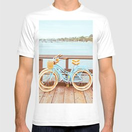 Two retro bicycles standing on Santa Barbara pier, California, USA. Vintage filter with muted teal blue and orange colors. T-shirt