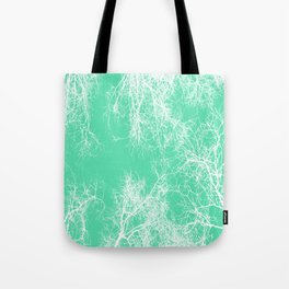 White silhouetted trees on green Tote Bag