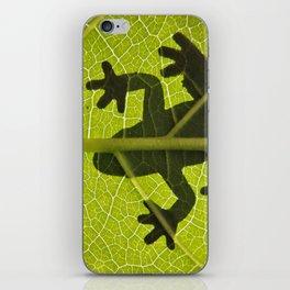 Frog on leaf against backlight iPhone Skin