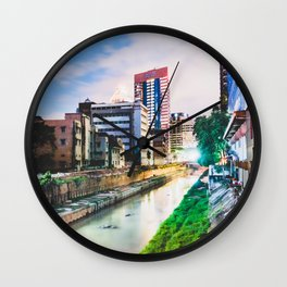 On going rapid urbanization leads to river pollution. Wall Clock