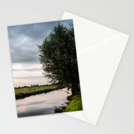 Green cottage at summer sunset Stationery Cards