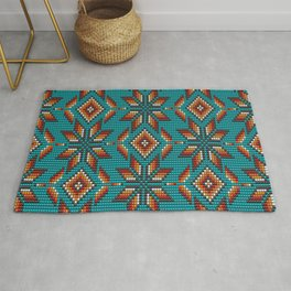 Modern colorful beaded boho aztec kilim pattern on teal Rug