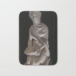Statue. Bath Mat