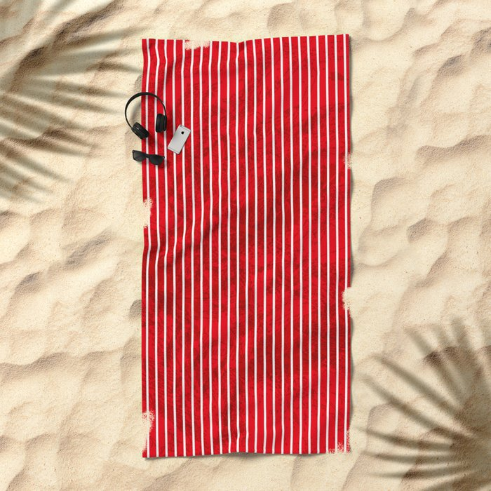 Red grunge stripes on white background Beach Towel