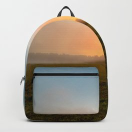 Blue sky at sunrise in a foggy haze Backpack