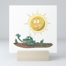 Funny frog in the scorching sun Mini Art Print