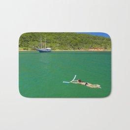 Woman swimming in green waters in Brazil Bath Mat
