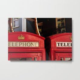Approaching the roof of two typical English telephone booths. Metal Print