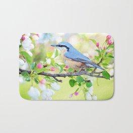 A Bird on a Blossoming Tree Branch Bath Mat