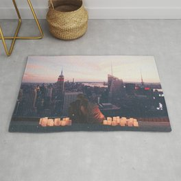 new york city skyline and couple-romance on the rooftop Rug