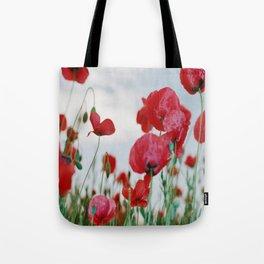 Field of Poppies Against Grey Sky Tote Bag
