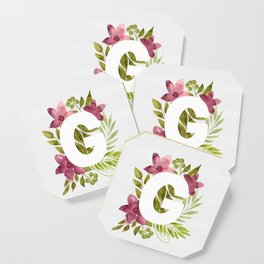 Monogram G with red waercolor flowers and green leaves. Floral letter G. Botanical illustration. Coaster